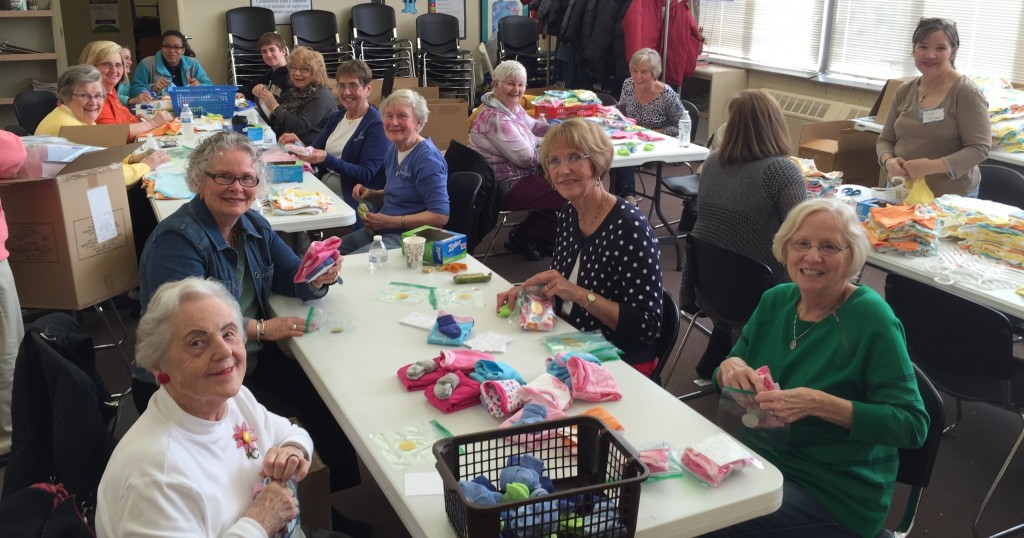 Volunteers making Layettes of Hope